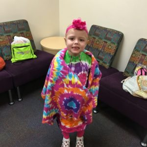 """Zoe loves her ComfyCozy shirts and wanted to wear them to school for show and tell. She tells everyone who asks about Amanda and even has her picture on the fridge. We see AHRA volunteers everywhere … painting children's nails in the clinic, feeding families every week, bringing gifts to inpatient children — and that's just at our hospital! They travel the Valley and beyond, helping families at other children's hospitals, too."" -Vanessa and Pete Mellas"