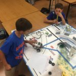 children playing with lego robots